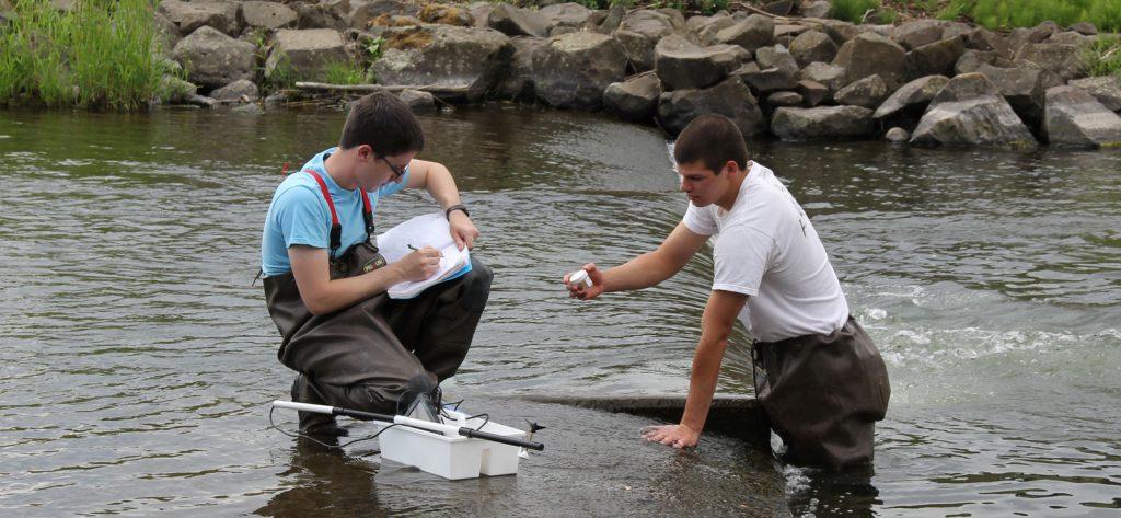 students in Mill Creek taking scientific measurements