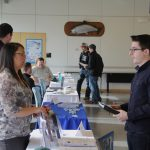 adults at informational desk